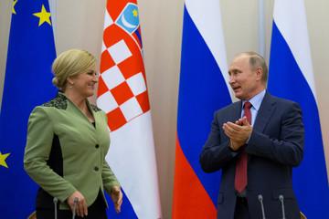 Russian President Vladimir Putin and Croatian President Kolinda Grabar-Kitarovic attend a joint news conference following their talks at the Bocharov Ruchei state residence in Sochi