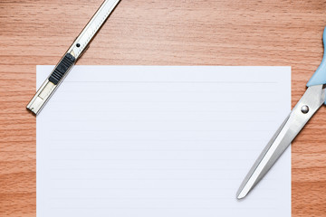 White line paper with official tools on brown wooden table