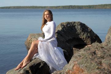 woman in a white dress at lake
