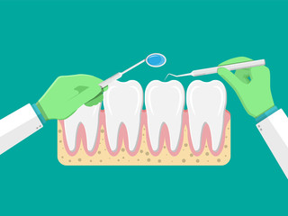 Dentist with tools examines teeth.