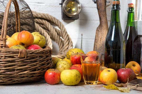basket of apples, bottles of cider