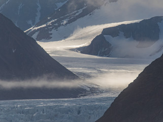 Light Flow - Spectral light flows with a glacial river. There are over 2100 glaciers in Svalbard.
