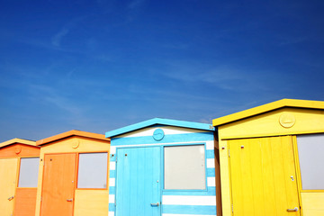 Colorful Beach Huts by the Sea in English Countryside