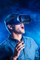 Portrait of a man wearing a virtual reality helmet
