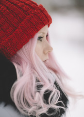 young woman with pink hair and red hat