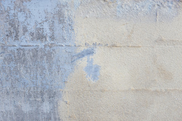 Peeling paint on concrete wall, close up