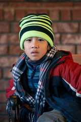 Portrait of a kid in winter clothes