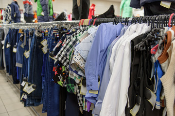 Clothing and jeans on a hanger