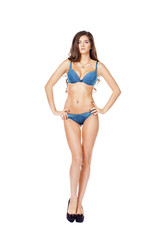 Full length beautiful slim tanned woman in bikini, isolated on white background
