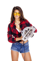 Sexy brunette woman mechanic with circular saw