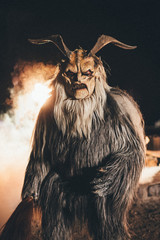 krampus with fire in the background - coming out of hell
