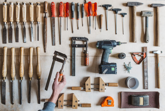 Man's hand holding a tool for woodworking