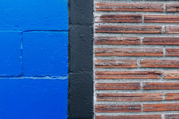 Detail of brick and painted cinderblock wall