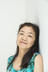 Senior Asian woman portrait with white background