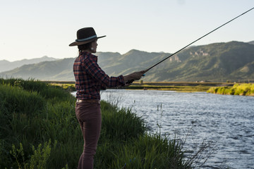 Woman spends a summer evening fly-fishing on the Salt River in Wyoming