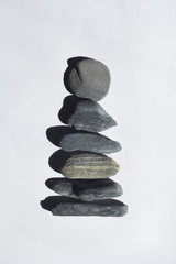 Stones stacked up against a white background.
