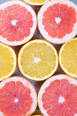Close up of sliced grapefruit and lemon as a background
