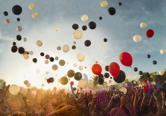 Big festival outdoors with music and balloons