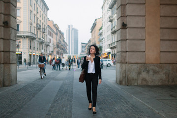Businesswoman walking in the business district