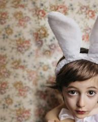 Overhead photo of a boy wearing bunny ears