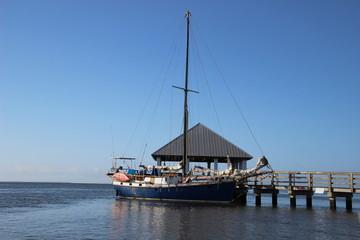 Yacht in marina on sunny day