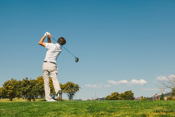 Golfer Playing Off the Tee Box