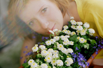 Close up portrait of young woman with flowers and rainbow