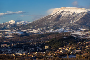 Morning winter view on the city of Gap and Ceuze mountain covered in fresh snow. Hautes-Alpes, Southern French Alps, France