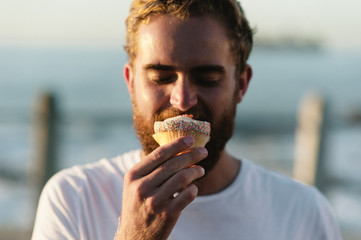 Man enjoying cupcake