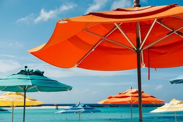 Colorful umbrellas on a tropical beach