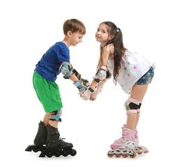 Cute children on roller skates against white background