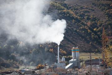 Dark smoke from chimneys of power plant