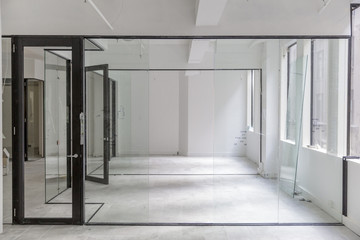 Wide view off office fit out with glass dividing walls being installed