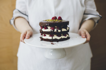 Woman holding cake