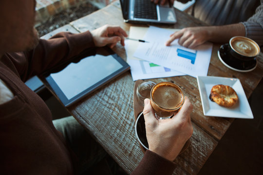 Cafe: Focus On Artisan Coffee While Businessmen Talk