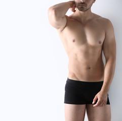 Sexy man in underwear on white background