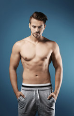 Sexy shirtless man on color background