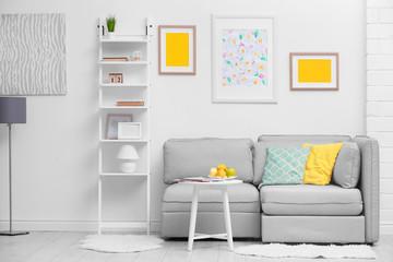 Modern interior with cozy grey sofa