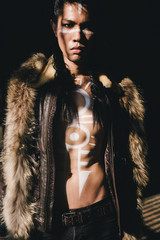 Young Man with Body Paint Drawing