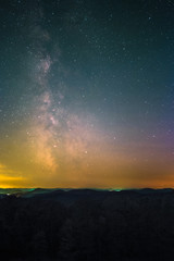The center of the Milky Way as seen from the Schänzel Tower on the summit of the mountain Steigerkopf in the Palatinate Forest near Edenkoben in Germany.