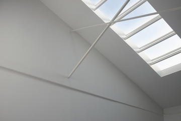 Architectural detail of a ceiling with a light window