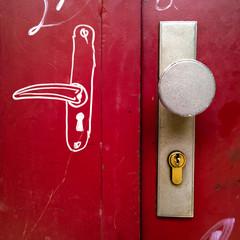Painted door handle on red door