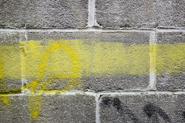 Paint covering graffiti markings on building wall, close up