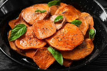 Dish with cooked sweet potato, closeup