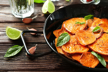 Dish with cooked sweet potato on table