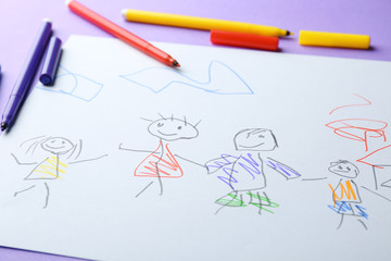 Child's drawing of family on color background, closeup