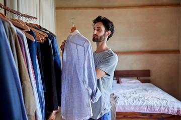 man choosing outfit