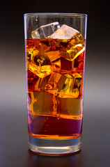 Orange Drink in a Glass of Ice on a Black Background