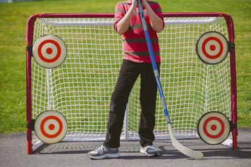 Portrait of Boy Playing Street Hockey