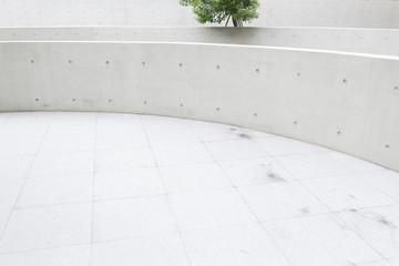 Circular tiled exterior outdoor patio with wall